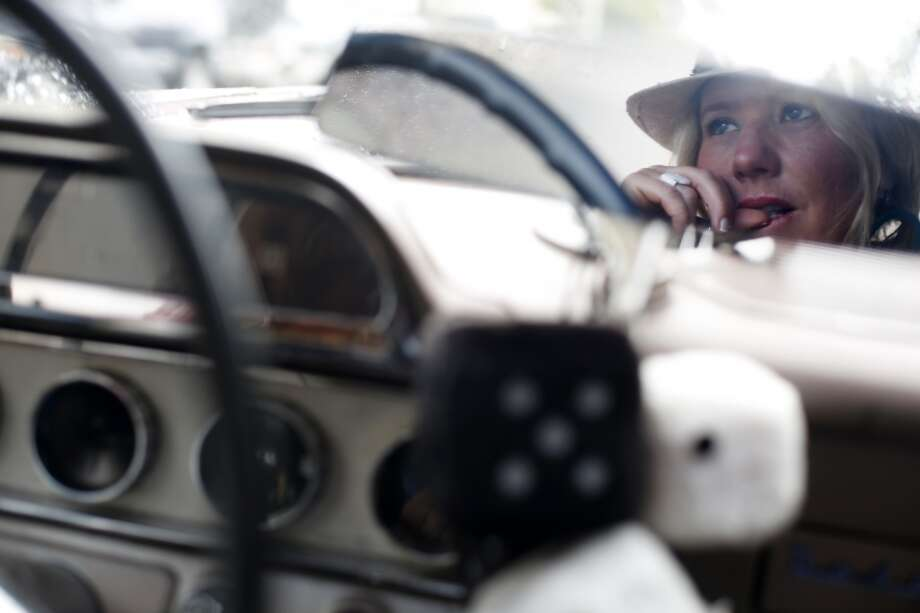 Parked in her 58 Dodge coronet, Siobhan Neilland waits for a friend to arrive. Photo: Mike Kepka, The Chronicle
