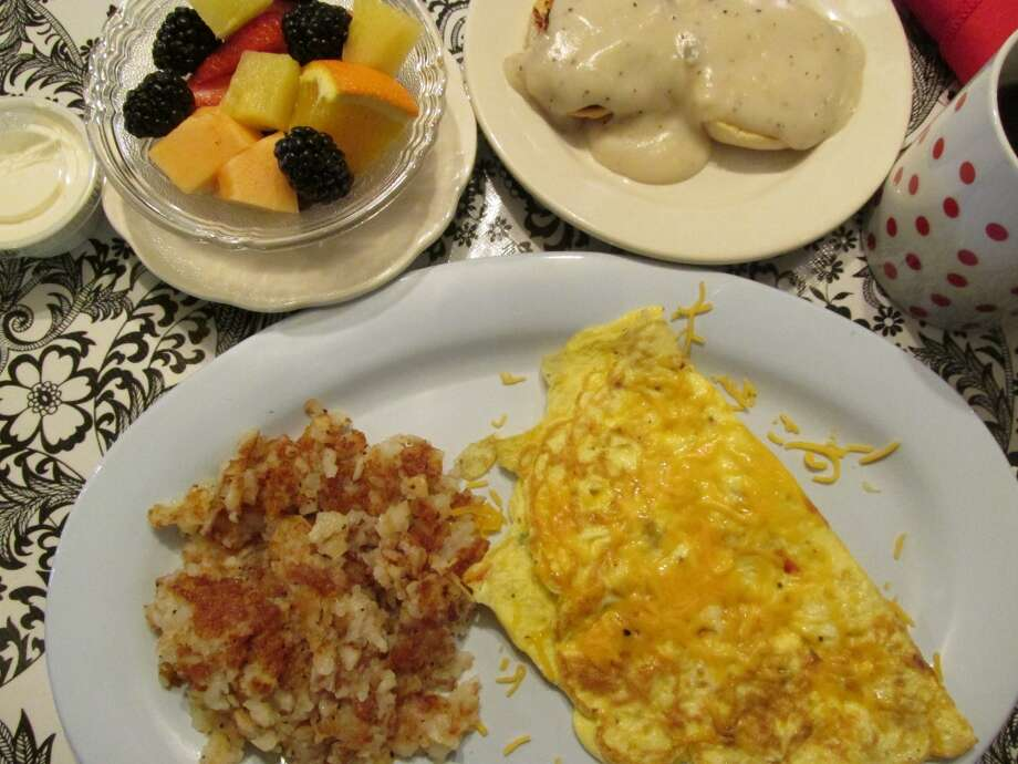 The veggie omelet served with hash browns, biscuits and homemade gravy and a fruit cup with homemade fruit dip at the Courtyard Cafe in Groves Photo: Cat5