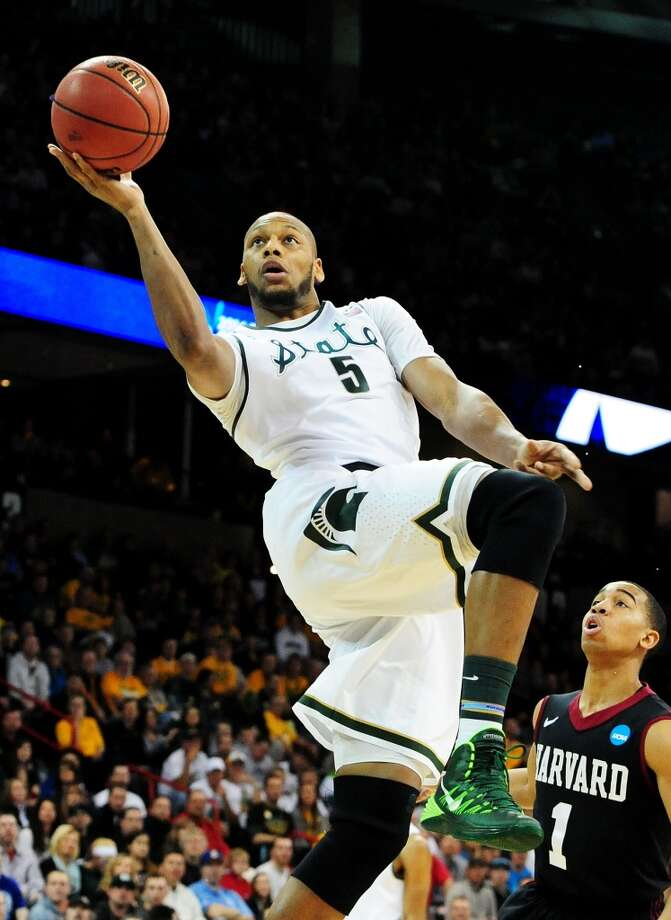 March 22: Third round  No. 4 Michigan State 80, Harvard 73 The Spartans survived a late rally by the Crimson to reach the Sweet 16. Photo: Steve Dykes, Getty Images