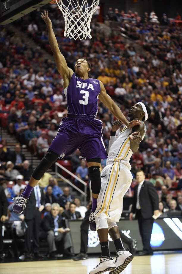 March 21: Second round  No. 12 Stephen F. Austin 77, VCU 75 (OT) The Lumberjacks had an impressive rally to force the extra period and pull off the upset. Photo: Denis Poroy, Associated Press