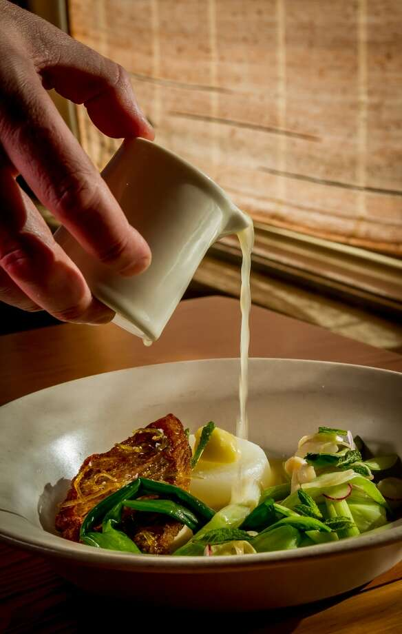 Citrus broth being poured over the tai snapper  at Torc. Photo: John Storey, Special To The Chronicle