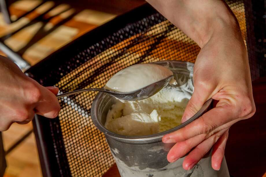 Ice cream being scooped for the Caramel Bar at Torc. Photo: John Storey, Special To The Chronicle