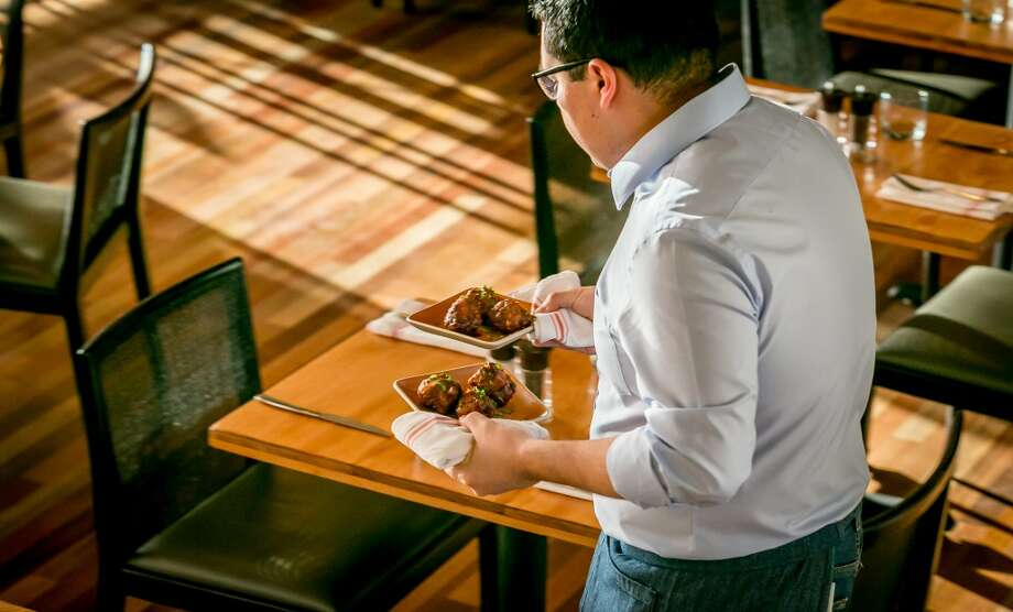 Chicken Wings being carried to a table at Torc in Napa. Photo: John Storey, Special To The Chronicle