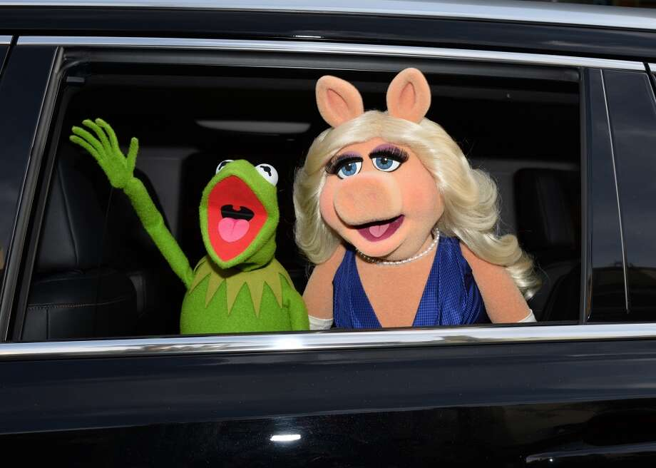 """Kermit and Miss Piggy, various """"Muppets"""" movies. OK, we love the Muppets, really. But this couple never made sense to us. Not only do they not have chemistry, they don't even have biology. And Kermit's much too nice for that diva. Photo: Kevin Winter, Getty Images"""