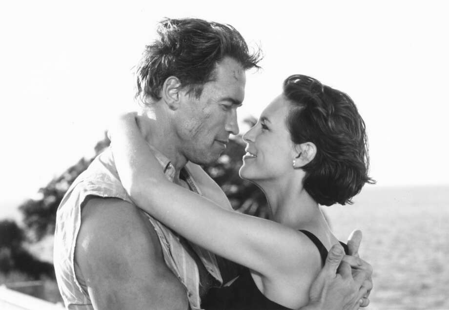 "Arnold Schwarzenegger and Jamie Lee Curtis co-star, ""True Lies.""