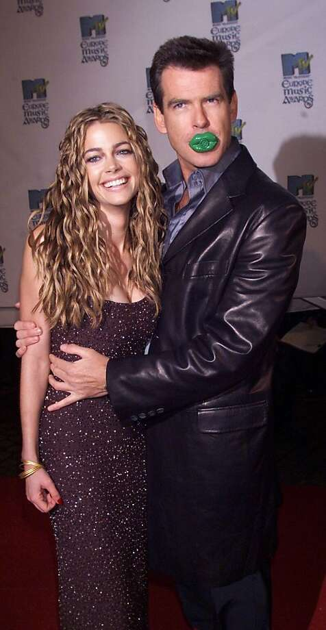 """Pierce Brosnan and Denise Richards, """"The World is not Enough."""" Aside from the whole age thing,  there's the idea of Richards as a nuclear physicist named """"Christmas Jones."""" Enough said. Photo: Dave Hogan/Getty Images"""