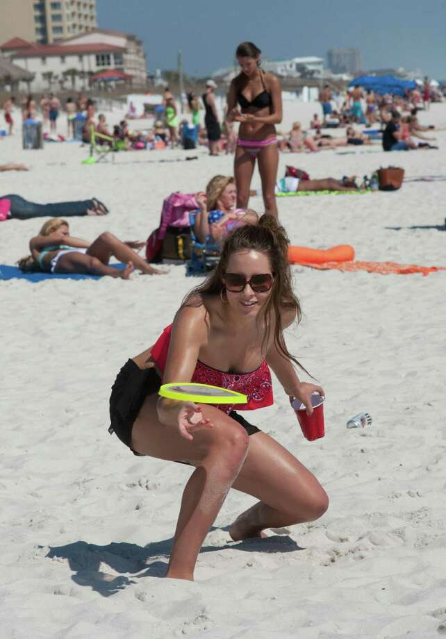 University of West Florida student Jennifer Herring plays frisbee during spring break on Monday, March 10, 2014, with a group of friends at Pensacola Beach in Pensacola, Fla. (AP Photo/The Pensacola News Journal, Tony Giberson)  Photo: Tony Giberson, AP / PENSACOLA NEWS JOURNAL2014