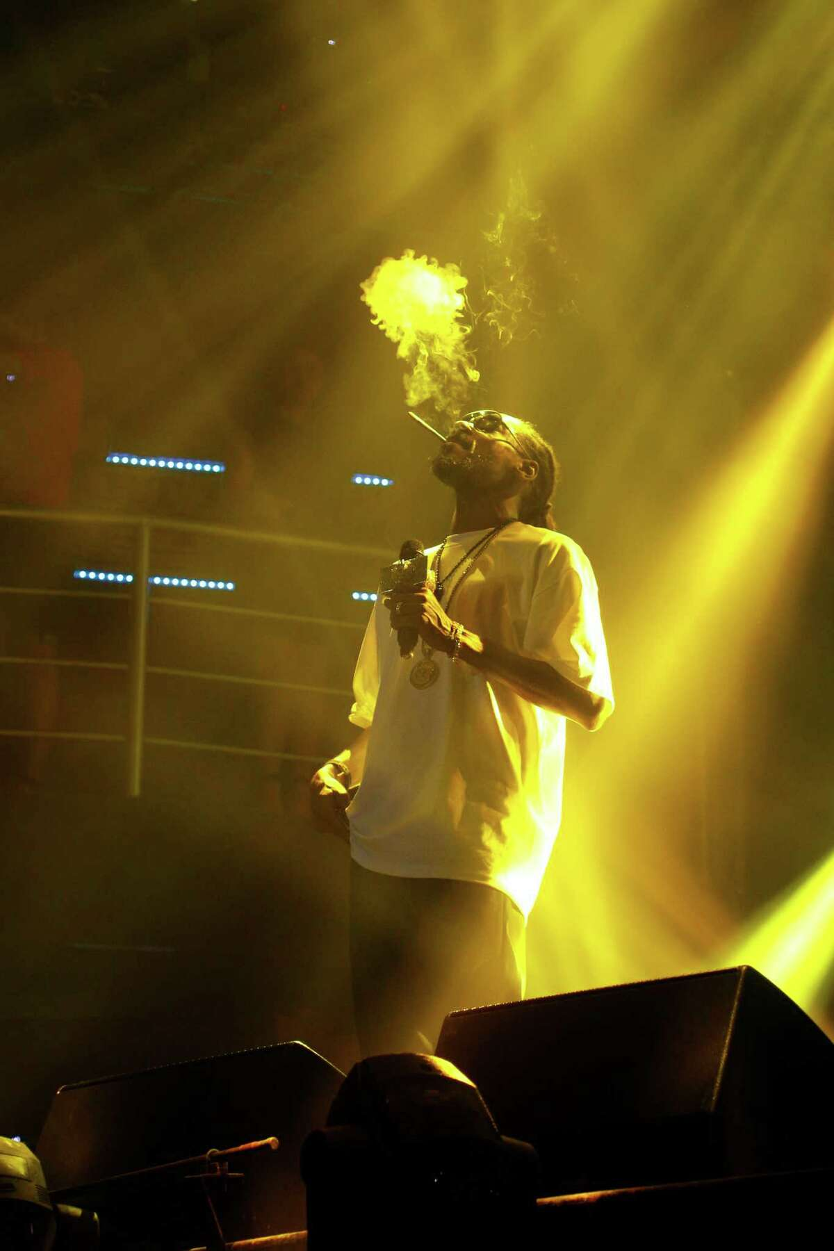 Rapper Snoop Dog performs at a discotheque in the resort city of Cancun, Mexico, Thursday March 13, 2014. Snoop Dog offered a concert as part of the activities in this city for this year's spring break season. Although violence in some border cities has quelled, spring breakers remain hesitant to take any chances in Mexico this year. While more Americans are returning to popular destinations such as Mexico City, Cancun and Los Cabos, the border communities have yet to see significant rebounds.