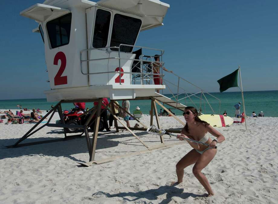 University of South Carolina spring breaker Michelle Meeder gets in a little recreation in the sun at Pensacola Beach in Pensacola, Fla. on Monday, March 10, 2014. Meeder is visiting the area with her brother Virginia Tech student, Matthew Meeder, who is also on spring break.(AP Photo/The Pensacola News Journal, Tony Giberson) Photo: Tony Giberson, AP / The Pensacola News Journal