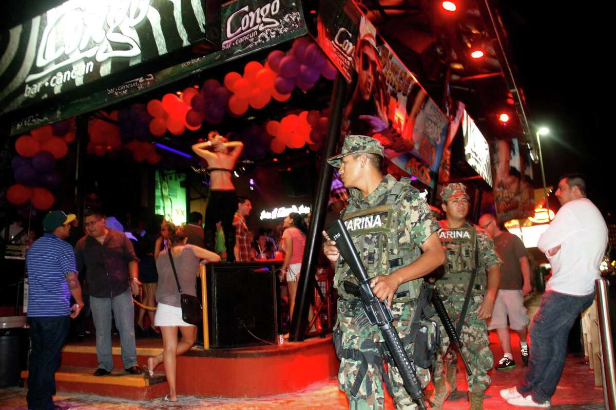 First up: Spring break was off to a crowded start in Cancun. In this photo, Mexican navy marines patrol the nightclub section as Spring Break revelers enjoy in the resort city of Cancun, Mexico, Feb. 26. Cancun is one of the No. 1 foreign destination for U.S. college students wanting to enjoy Spring Break. (AP Photo/Israel Leal)