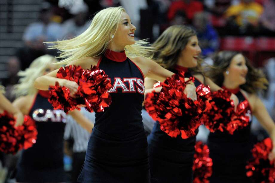 Arizona cheerleaders perform as the team plays Gonzaga during the first half of a third-round game in the NCAA college basketball tournament Sunday, March 23, 2014, in San Diego. (AP Photo/Denis Poroy) Photo: Denis Poroy, Associated Press / FR59680 AP
