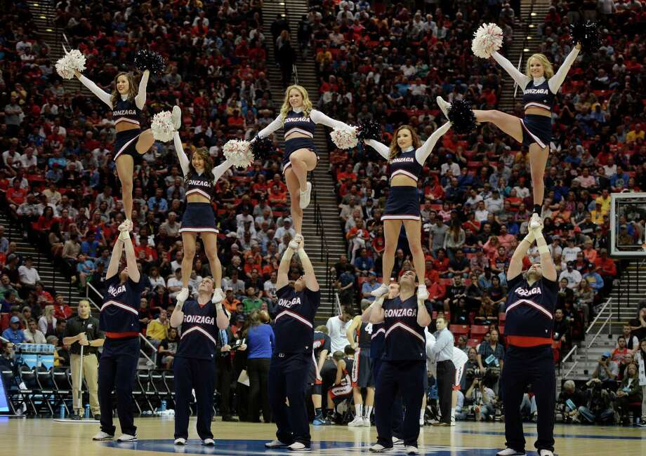 SAN DIEGO, CA - MARCH 23:  Arizona Wildcats cheerleaders perform against the Gonzaga Bulldogs during the third round of the 2014 NCAA Men's Basketball Tournament at Viejas Arena on March 23, 2014 in San Diego, California. Photo: Donald Miralle, Getty Images / 2014 Getty Images