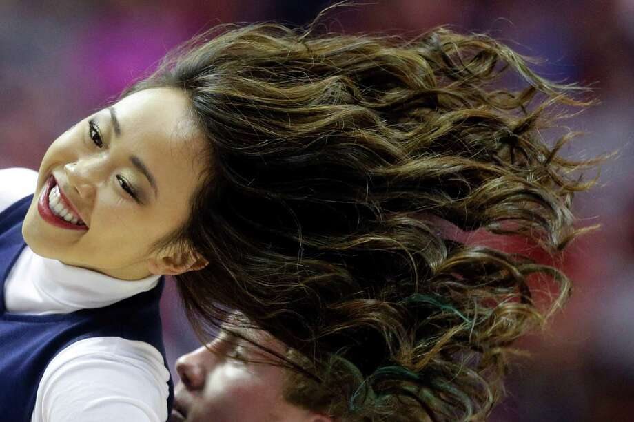 Hair flies as Gonzaga cheerleaders perform during the first half of a third-round game between Gonzaga and Arizona in the NCAA college basketball tournament Sunday, March 23, 2014, in San Diego. (AP Photo/Lenny Ignelzi) Photo: Lenny Ignelzi, Associated Press / AP