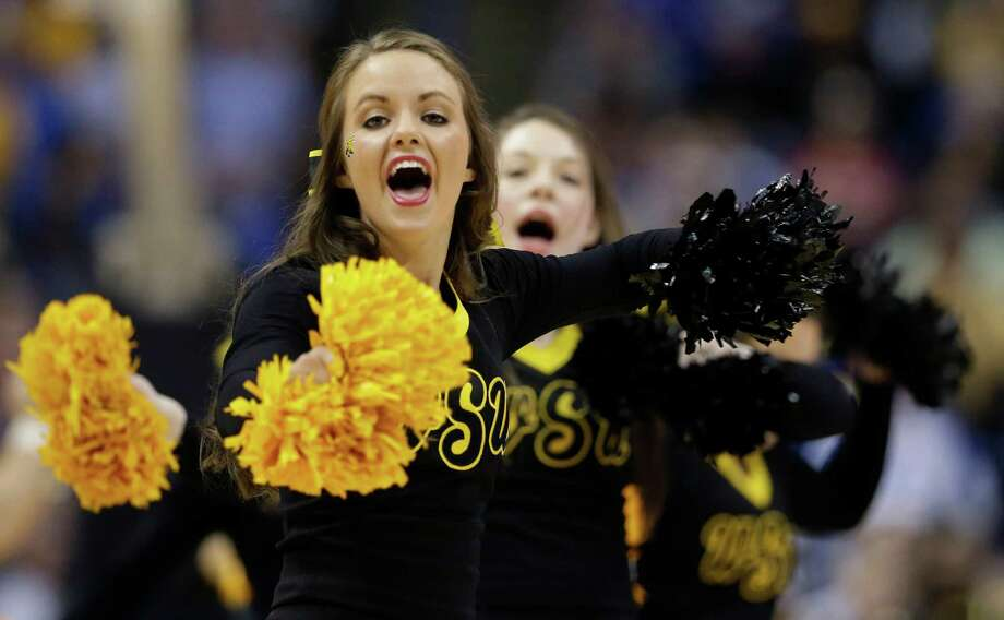 Wichita State cheerleaders perform during the second half of a third-round game against Kentucky at the NCAA college basketball tournament Sunday, March 23, 2014, in St. Louis. (AP Photo/Charlie Riedel) Photo: Charlie Riedel, Associated Press / AP