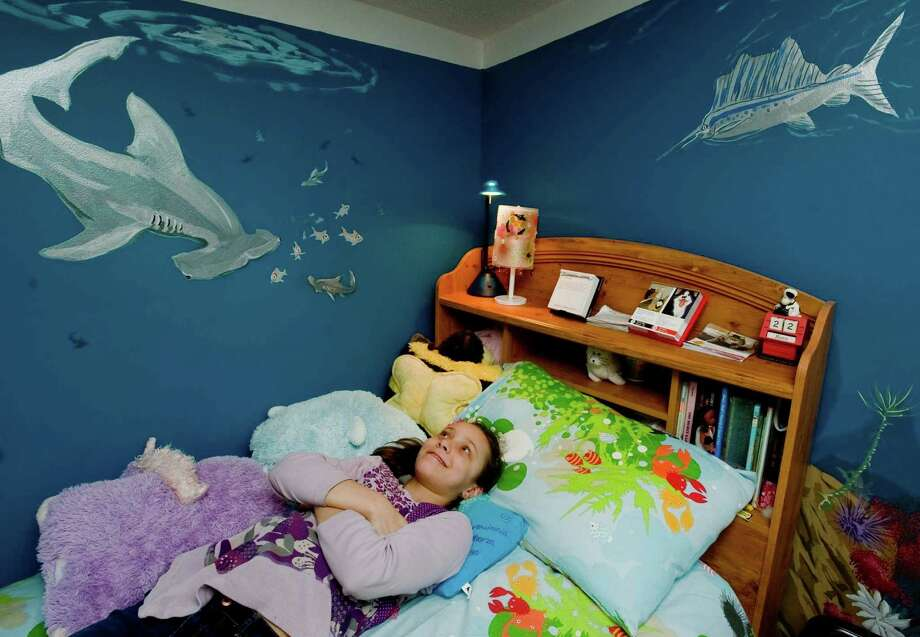 Ten-year-old Emilie Tenore of Redding in her bedroom, surrounded by the ocean. She loves sea life so her parents had Victor DeMasi of Redding paint a huge mural on her bedroom wall as a birthday gift. Saturday, March 22, 2014 Photo: Scott Mullin / The News-Times Freelance