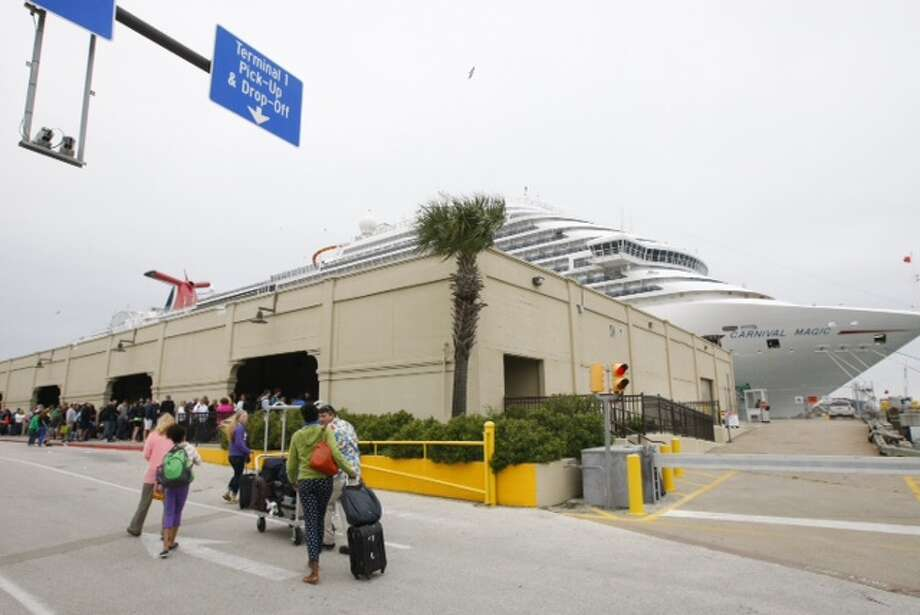 Passengers wait to board a cruise ship early Monday morning at the Port of Galveston. Photo: Cody Duty