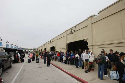 Passengers wait to board a cruise ship early Monday morning at the Port of Galveston. Photo: Cody Duty, Houston Chronicle