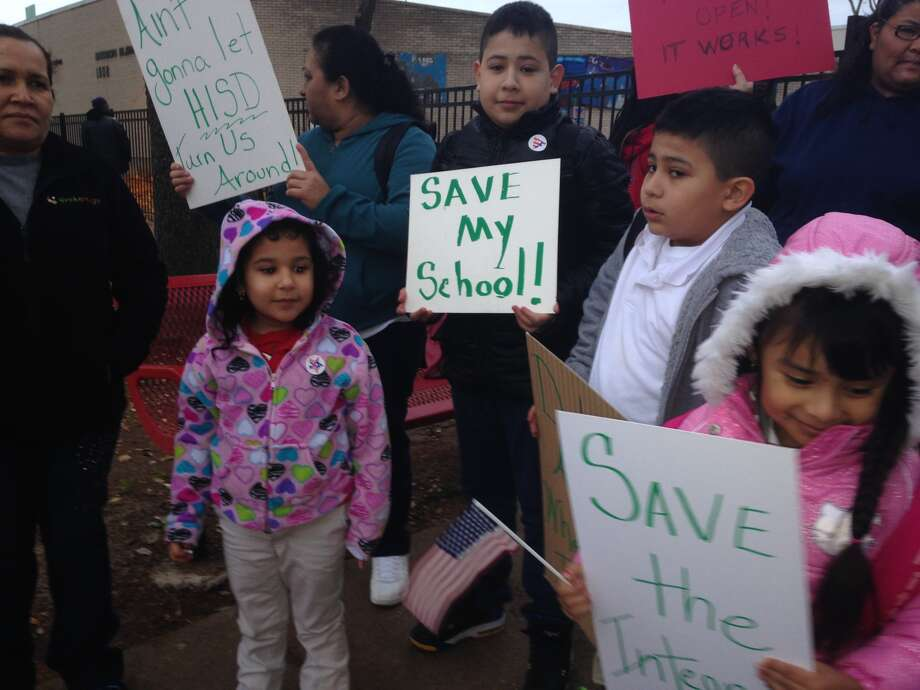 Dozens of parents, students and community leaders quietly protested Monday morning over Houston Independent School District's planned closure of Dodson Elementary. Photo: Ericka Mellon, Houston Chronicle