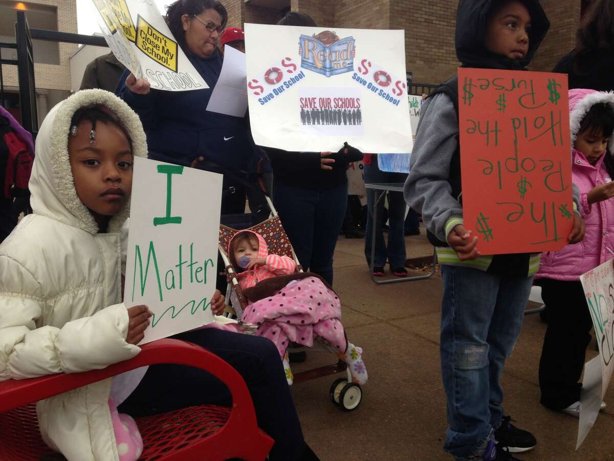 Dozens of parents, students and community leaders quietly protested Monday morning over Houston Independent School District's planned closure of Dodson Elementary.