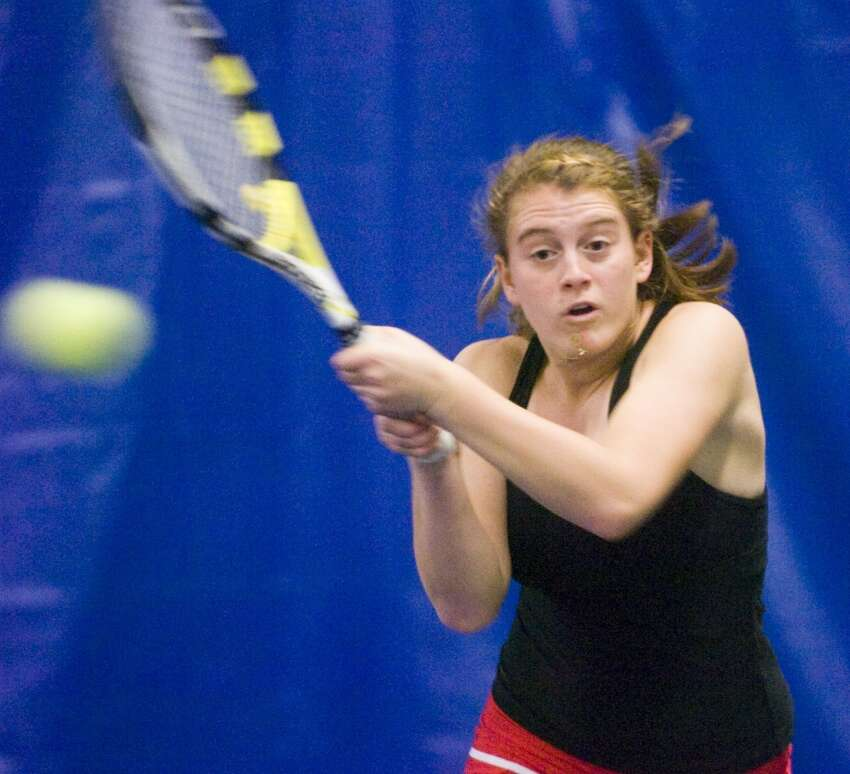 New Canaan's Kimmy Glerum in doubles action as New Canaan High School hosts Greenwich in a girls tennis match at Old Kings Highway Indoor Tennis in Darien, Conn., May 17, 2011. Glerum teamed up with Sara Greene for the top doubles match.