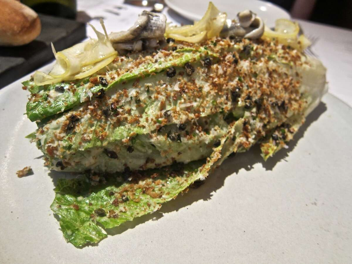 Caesar salad with toasted bread crumbs, dehydrated capers, preserved lemon and anchovy at Provisions.