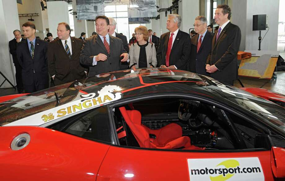 From left: Assemblyman Chris Friend, Assemblyman Phil Palmesano, Michael Printup, president Watkins Glen International, Sen. Tom O'Mara, Sen. Betty Little, Senate Republican Leader Dean Skelos, Assembly Speaker Sheldon Silver and Gov. Andrew Cuomo check out a Ferrari after the governor announced the Ferrari Challenge race will take place at Watkins Glen International September 19-21 during a press conference at the New York State Museum on Thursday, March 20, 2014 in Albany, N.Y. (Lori Van Buren / Times Union) Photo: Lori Van Buren / 00026224A