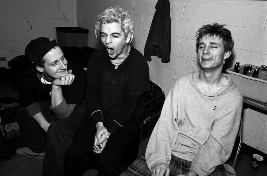 Green Day: It would take Mike Dirnt, Tre Cool and Billie Joe Armstrong a few years to become household names but they were still teenagers when they dropped their first release, 1,000 Hours, and became a regular attraction at the Berkeley punk club 924 Gilman Street. Photo: Catherine McGann, Getty Images