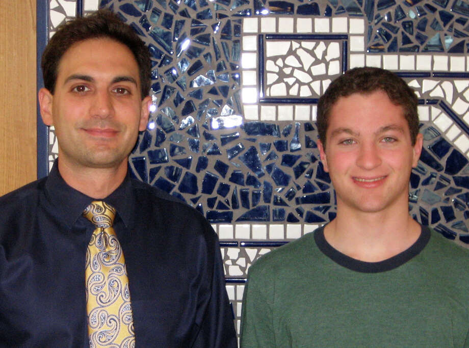 Zach Effman, right, a Staples High School junior who has been selected to be an intern at the Massachusetts Institute of Technologyís Research Science Institute this summer, with Staples teacher Nicholas Morgan. Photo: Contributed Photo / Westport News