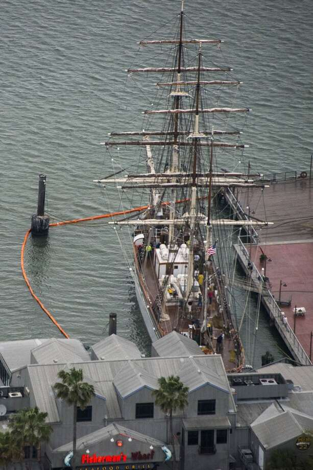 Protective boom surrounds tall ship Elissa at the Port of Galveston on Sunday, March 23, 2014, in Galveston, Texas. Dozens of ships are in evolved in clean-up efforts to remove oil that spilled into Galveston Bay after a ship and barge collided near the Texas City dike on Saturday afternoon. Photo: Smiley N. Pool, Houston Chronicle