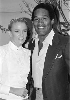 FILE--This is a 1980 file photo of O.J. Simpson and his future wife Nicole Brown at a party in the Beverly Hills section of Los Angeles in May of 1980. Nicole Simpson and Ronald Lyle Goldman, 25, were found dead outside her condominium shortly after midnight Monday June 13, 1994 in Los Angeles. (AP Photo)