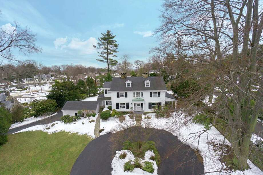 The five-bedroom Colonial at 7 Cross Road in Darien is tucked away in the secluded Tokeneke neighborhood, which offers some of the most exquisite real estate on the Gold Coast. The home, built in 1907 by a group of wealthy New Yorkers who formed the Tokeneke Corporation, is on the market for $2,475,000. Photo: Contributed Photo, Contributed / Darien News