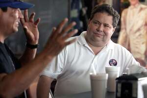 Congressman Blake Farenthold talks with Corpus Chrisiti Army Depot employee, Ross Gonzales, during a meet and greet at Boardwalk Café in Coprus Christi, Texas on NAS Drive Thursday, August 8, 2013. Farenthold was in the area to meet with business owners on how the furloughs have affected them and their businesses. (AP Photo/Corpus Christi Caller-Times, Todd Yates)  MANDATORY CREDIT; MAGS OUT; TV OUT