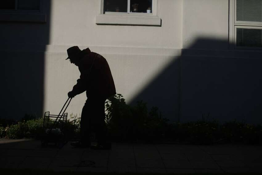 Allen Stross returns to his home after lunch at the North Berkeley Senior Center and some grocery shopping.