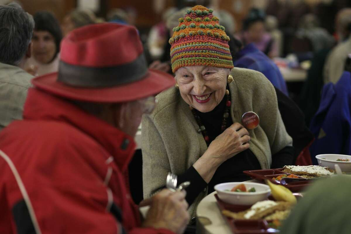 Hyshka Stross (right) smiles as she talks with her husband Allen Stross (left) while they eat lunch at the North Berkeley Senior Center on Thursday, December 12, 2013 in Berkeley, Calif.