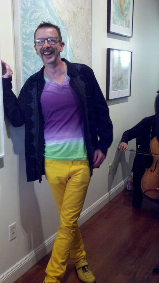 Mark Garrett, the artist, in yellow pants Photo: Leah Garchik