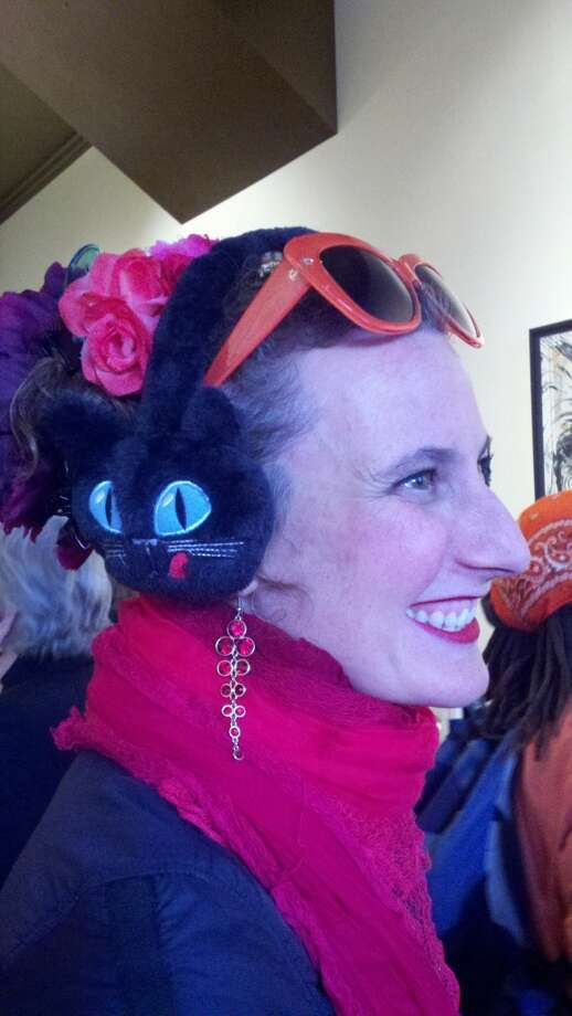 Jessica Anne Schwartz, the artist's studio-mate, in cat/Frieda Kahlo chapeau Photo: Leah Garchik