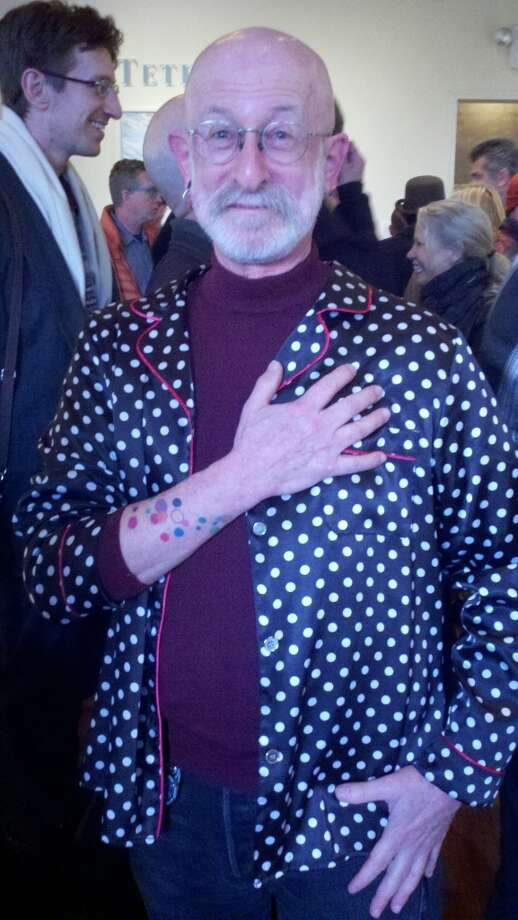 John Karr in polka dots in keeping with  the dots tattooed on his arm Photo: Keeping