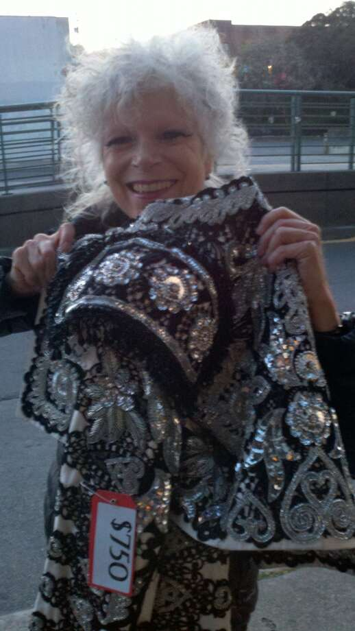 Fay Wilson showing what she'd snagged earlier in the evening at the SF Opera costume sale Photo: Leah Garchik