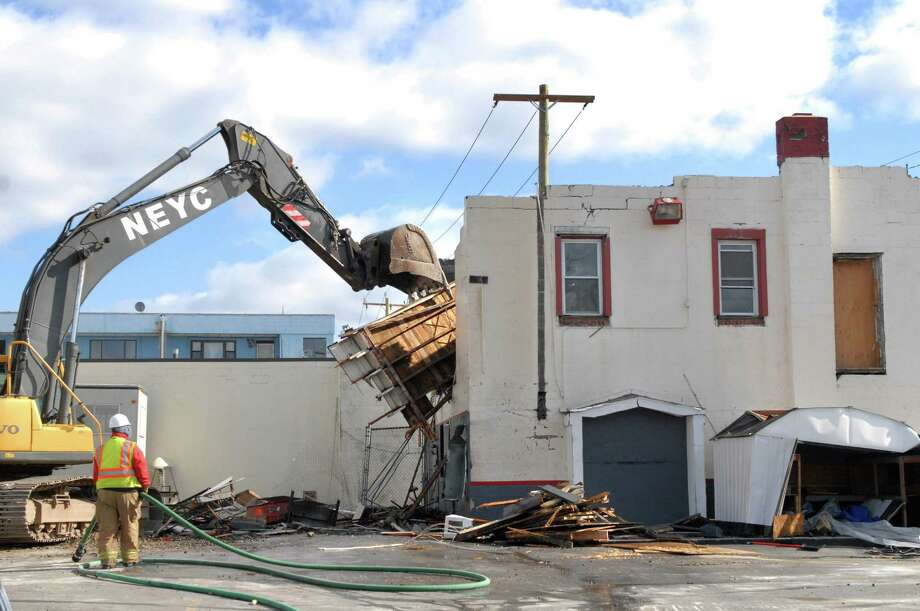 Demolition on DeYulio's Sausage Company at 384 Elm Street and Myrtle Ave in Stamford, Conn. started on on Monday, March 24, 2014 as part of the Urban Transitway project. The demolition is expected to end by Friday, March 28. Photo: Dru Nadler / Stamford Advocate Freelance