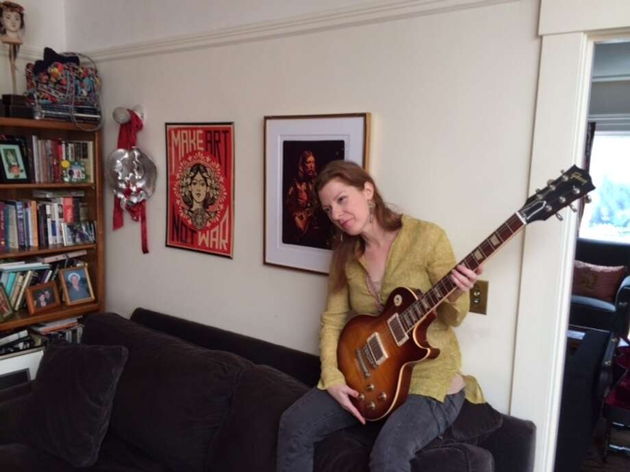 Galadrielle Allman with a replica of her dad's Les Paul at her home in Berkeley.  The Chronicle/Sam Whiting