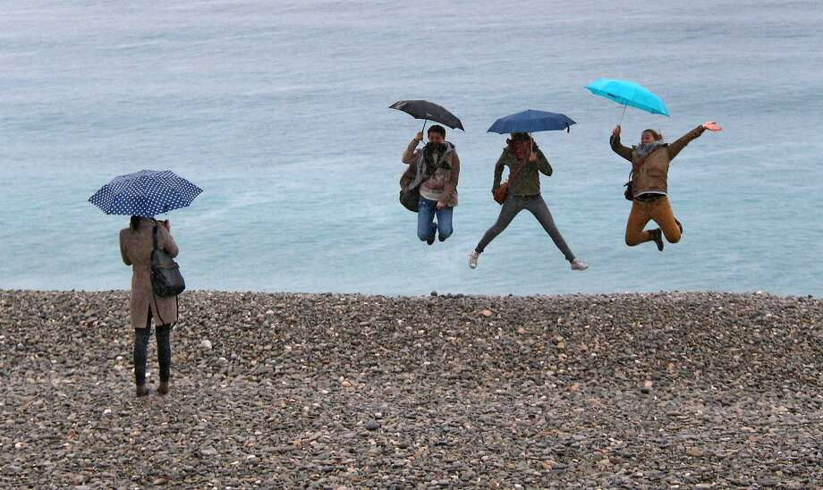 We had just gathered for a group portrait when a sudden gust of wind ... Tourists pose for 