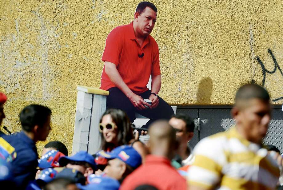 Two-dimensional dictator:The late Venezuelan president Hugo Chavez - or at least a life-size cutout of him - makes an appearance at a rally for current President   Nicolas Maduro in Caracas.  Photo: Leo Ramierz, AFP/Getty Images