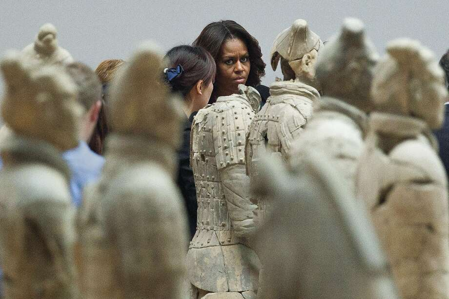 Michelle Obama, Terracotta Warrior:Accompanied by her daughters and mother (not shown), the first lady visits the famous Qinshihuang Terracotta   Warriors and Horses Museum in Xi'an, China. Photo: Alexander F. Yuan, Associated Press