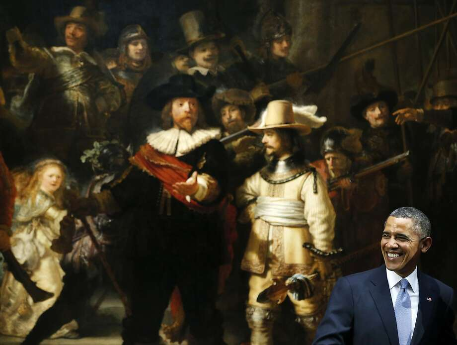 """Dutch treat:President Obama visits Rembrandt's """"The Night   Watch"""" at the Rijksmuseum in Amsterdam. The president was attending a two-day Nuclear Security Summit in The Hague. Photo: Frank Augstein, Associated Press"""