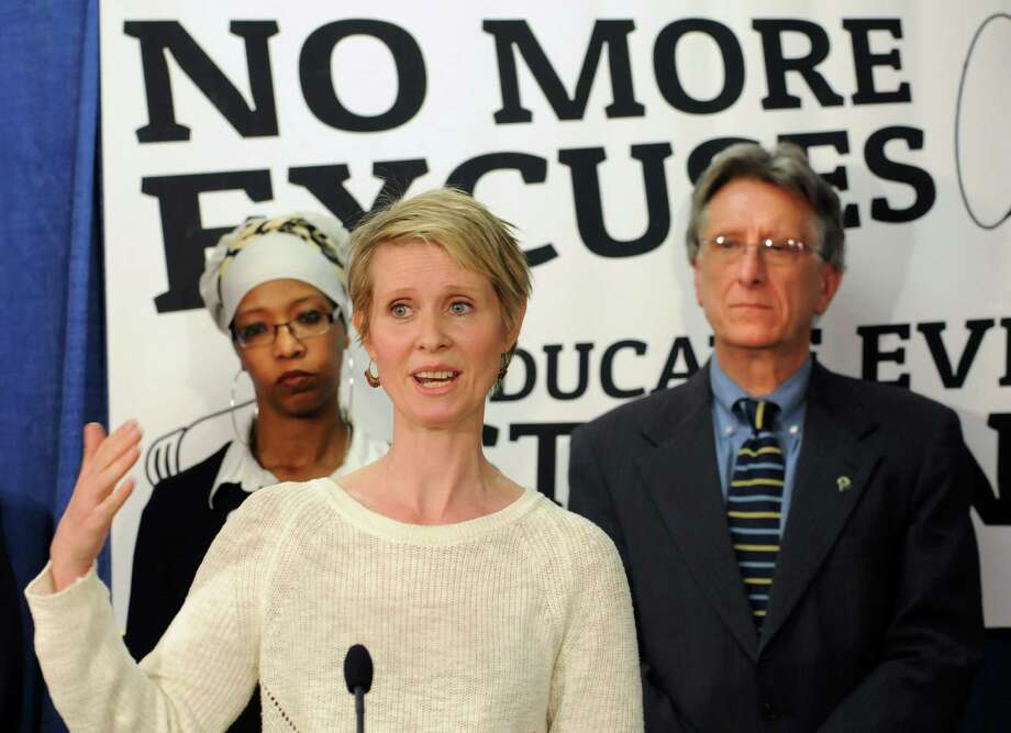 Actress and education advocate Cynthia Nixon speaks during a press conference  with school superintendents, academics and other officials to push for more funding for schools Monday, March 24, 2014, at the Legislative Office Building in Albany, N.Y.  Advocacy Director for the Alliance for Quality Education Zakiyah Ansari, left, and Fairport Central School District Superintendent William Cala stand in background.  (Lori Van Buren / Times Union) Photo: Lori Van Buren / 00026240A
