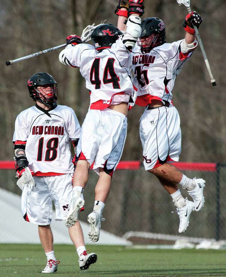 The New Canaan boys lacrosse team celebrates a goal scored against Darien during a game at New Canaan High School on Tuesday April 16th, 2013. Photo: Mark Conrad / Stamford Advocate Freelance