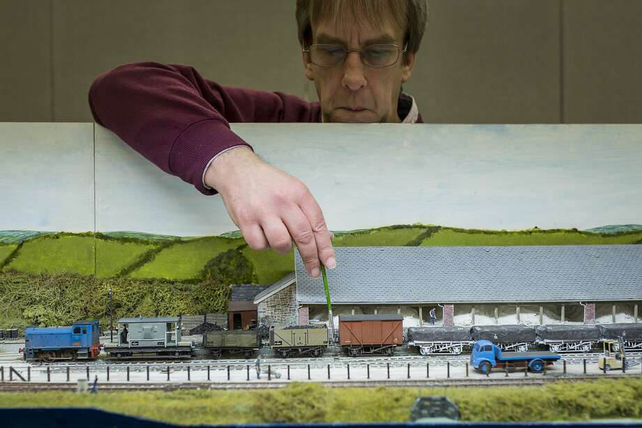Geoff Sheppard tweaks his model railway, which was inspired by China's clay industry at The London Festival of Railway Modeling at Alexandra Palace. Photo: Rob Stothard, Getty Images