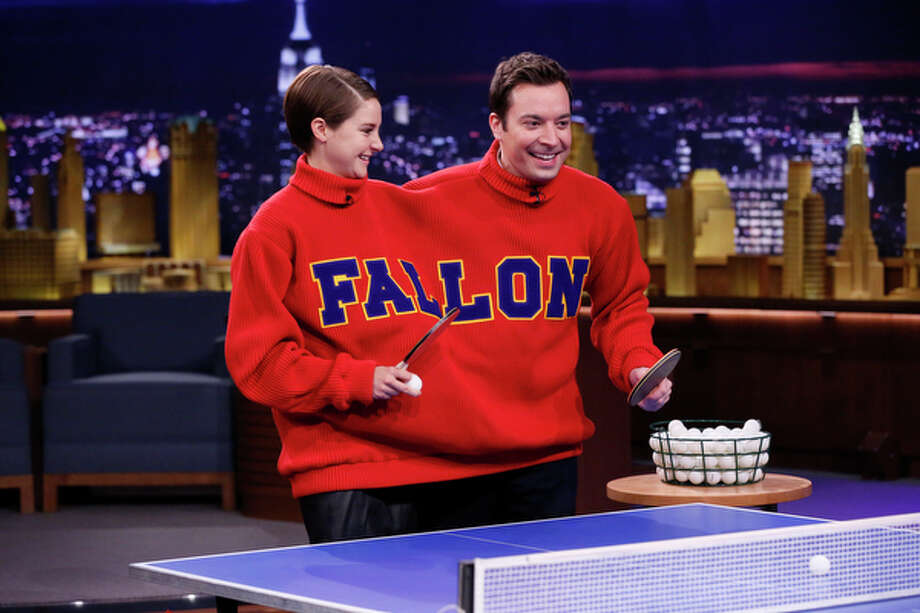 "This image released by NBC shows host Jimmy Fallon, right, and actress Shailene Woodley playing a game of Double Turtleneck Ping Pong, Wednesday, March 12, 2014 during a taping of ""The Tonight Show Starring Jimmy Fallon,"" in New York. Woodley appeared on the show to promote her new film, ""Divergent."" (AP Photo/NBC, Lloyd Bishop) ORG XMIT: NYET317 Photo: Lloyd Bishop / NBC"
