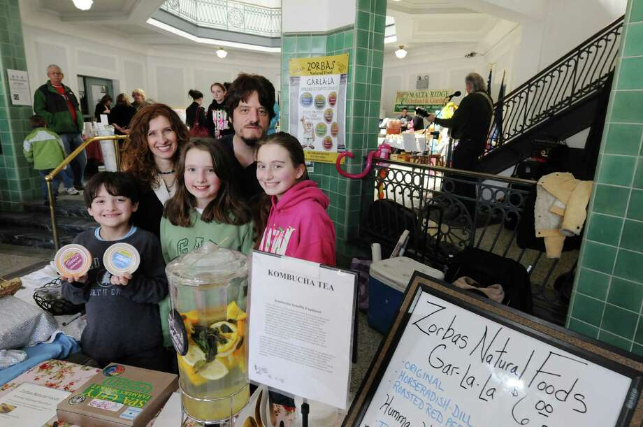 Colleen and Foti Zorbas poses with their children, John, 8, Demetra, 11, and Callista, 13, at their family business, Zorbas Natural Foods, booth at the Spa City Farmers' Market on Sunday, March 23, 2014, in Saratoga Springs, N.Y.  (Paul Buckowski / Times Union) Photo: Paul Buckowski / 00026212A