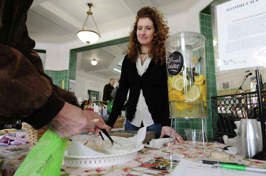 Colleen Zorbas, works at her family business, Zorbas Natural Foods, booth at the Spa City Farmers' Market on Sunday, March 23, 2014, in Saratoga Springs, N.Y.  (Paul Buckowski / Times Union) Photo: Paul Buckowski / 00026212A